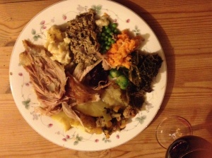 Christmas Dinner: Roast Turkey, Nut Loaf, Stuffing, Mashed Carrots and Turnip, Roast Potatoes, Mashed Potatoes, Peas, Brussels Sprouts, Apple Sauce, Cranberry Sauce, and Two Types of Gravy