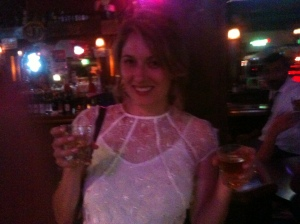 The bride having post-Wedding drinks at the 2 a.m club. La classe.